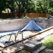 AFTER - 30+ year old concrete wall pool with new cement lock/bull nose coping, new concrete decking and new vinyl liner.