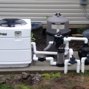 Electric heat pump pool heater, Hayward D.E. filter and pump with automatic chlorine dispenser.