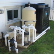 Electric heat pump pool heater, Pentair D.E. filter and pump with a Hayward automatic chlorine dispenser.