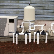 Pentair natural gas pool heater, Pentair D.E. filter and dual pumps. One for the filtration system and one for the attached spill over spa.