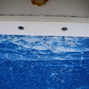Liner damage due to putting chlorine tablets in skimmer.