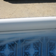 AFTER - Pool-owner painted bull-nose coping with anti-slip texture coping paint before new liner was installed.