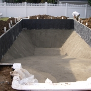 URING – Wall concreted in place, and vermiculite hard-bottom installed.