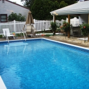 """BEFORE - """"Dream Pool"""" wood wall pool with 8"""" aluminum coping and drop-in steps. The walls are deteriorating and starting to collapse."""