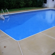 AFTER - All new polymer wall pool installed. All excavations were hand dug due to access limited to a 3' area around pool. The new pool was filled with water the same week.