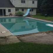 "Before - Basic rectangle pool with worn concrete decking and 2"" bullnose coping and antique blue slide."