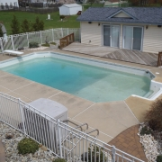 BEFORE - Basic Grecian Pool with concrete decking.