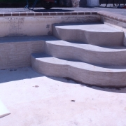 In Progress - Freeform poured concrete step.