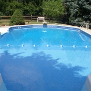 AFTER - Polymer wall pool with a makeover including a new vermiculite bottom, liner and pressure washed deck.