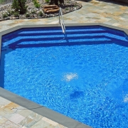 Steps complete - 18' step and bench installed with dip to pool handrail.
