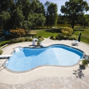 "BEFORE - ""Mountain Lake"" vinyl lined pool with brick coping."
