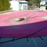 BEFORE - Old freeform bungi cord style safety cover.