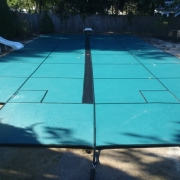 Green Solid Safety Cover with Commercial Black Mesh Center Drain.