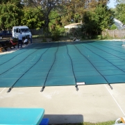 AFTER - Green Ultra-Mesh Safety Cover on a commercial pool.