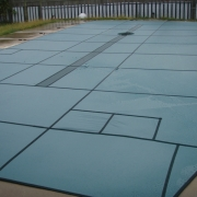 AFTER - Solid Green Safety Cover with Green Ultra-Mesh Center Drain.