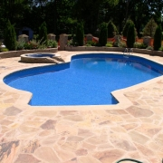 BEFORE - Freeform vinyl liner pool with spa with hand laid sandstone decking.