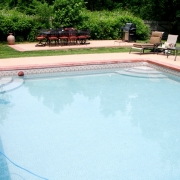 """Dual- """"wedding cake"""" steps installed in opposite corners of a 20' x 40' pool."""