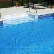 8- polymer cantilever Sit-n-Step unit with two handrails. Liner pattern: Hampton Tile/ Laguna