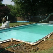 """AFTER - Fiberglass wall (Dream Pool) straightened walls with new """"A"""" frame supports, and new aluminum cement lock/bull nose coping prepped and ready for new concrete."""