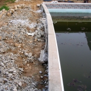 BEFORE - Dream/Islander Pool with wood wall bowing in.