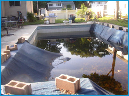 "Winter cover installed with cinder blocks which were ""blown"" into the pool during a storm."