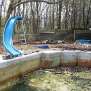 BEFORE - Steel wall pool after years of neglect and exposure to the weather.