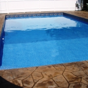 Stamped concrete with cantilever decking/coping.caption