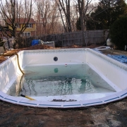 "BEFORE - Dream/Islander Pool with roman end and 8"" aluminum coping."