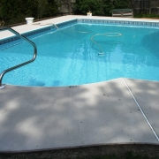 AFTER - Dream/Islander Pool with new aluminum cement lock/bull nose coping, new concrete decking and new liner. Liner Pattern: Cheyenne/Crystal