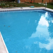 Before - 3 year old concrete wall pool with sand bottom and stone coping.