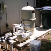 Pentair D.E. filter and pump with a salt water chlorine generator. Filtration area was oversized to allow for the future installation of a pool heater.