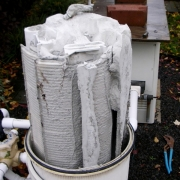 BEFORE - Filter clogged with excessive amounts of D.E. reducing both the water flow and the filtration area of the filter.