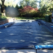 TARP COVER WITH AUTOMATIC COVER PUMP