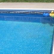 Liner damage due to chlorine floater stuck in corner.