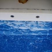 Liner damage due to putting chlorine tablets in skimmer.
