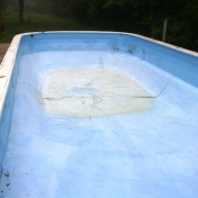 BEFORE - 40+ year old concrete pool.