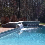 Sheer decent water feature installed after original pool installation.