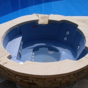 Spill-over spa added to a vinyl liner pool when doing renovation.