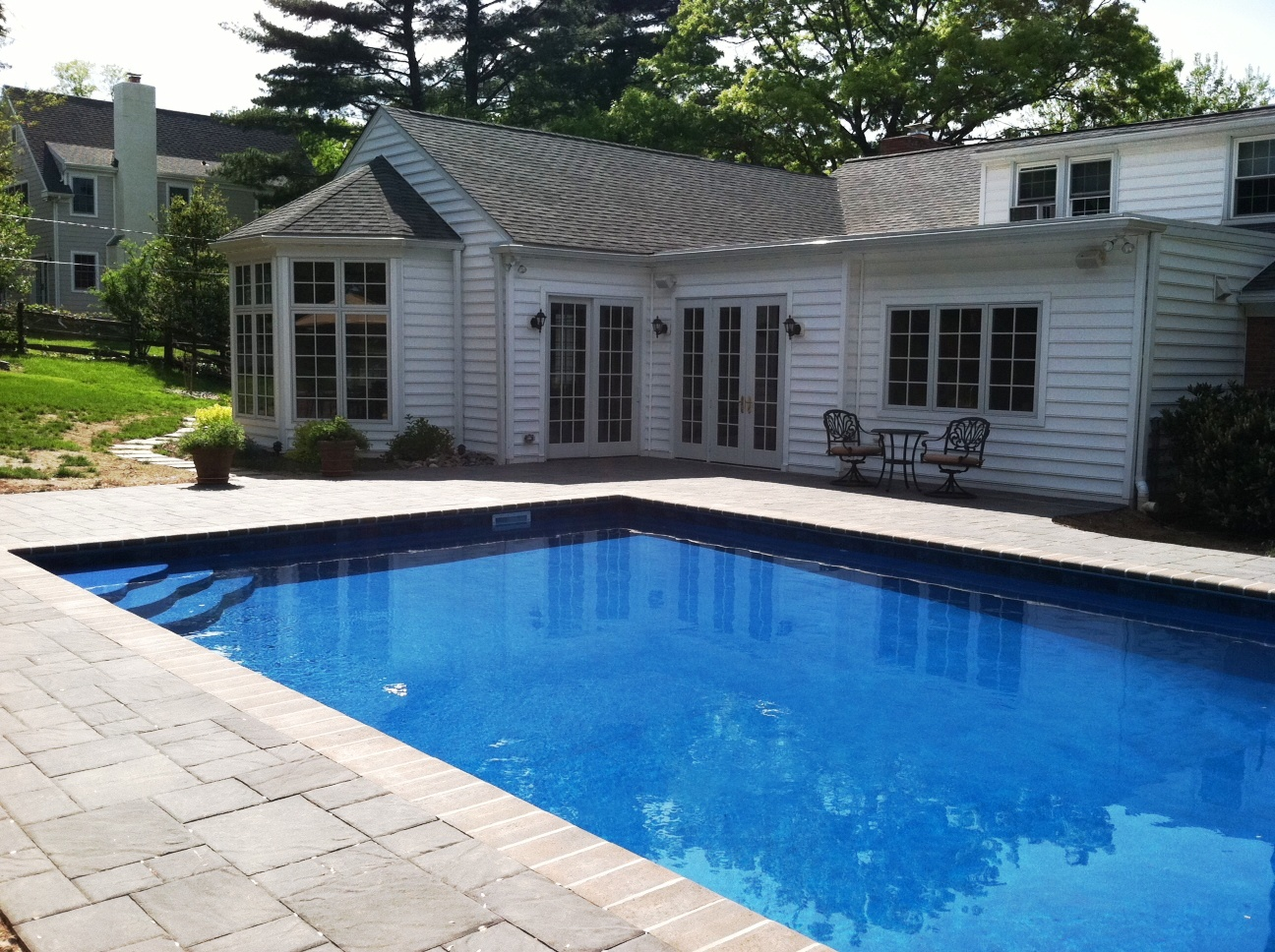 After Concrete Pool With New Retrofit Liner Freeform Step Bull Nose Paver Coping And Deck