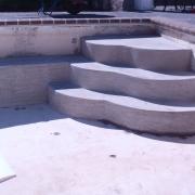 In Progress - Freeform poured concrete step.