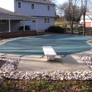 BEFORE - Polymer wall pool with plastic tracking, white acrylic step and cracking cantilever concrete decking.