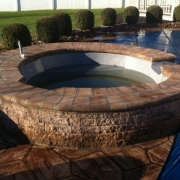 AFTER - Hot tub after re-installation and the addition of a stone sitting wall.