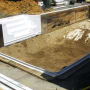 "BEFORE - Renovation of a wood wall ""Dream pool"" in progress. Deep end depth has been raised and steps have been installed."