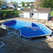 In Progress - Reconfigured pool shape, new v-lite bottom, installed liner.