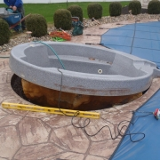 BEFORE - Existing hot tub that popped out of the ground.