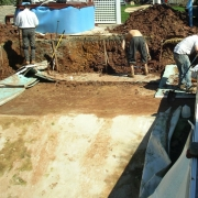 In Progress- Pool is drained and all damaged wall panels are removed. Dirt behind wall panels is hand excavated to allow installation of the new wall panels and supports.