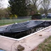 BEFORE - Anthon / Sylvan Pool with loose coping, under-sized skimmers, no steps, and sagging, cracking concrete decking.