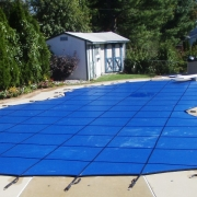 AFTER - Solid Blue Freeform Safety Cover with heavy duty springs.