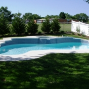BEFORE – Freeform concrete pool with raised spa.