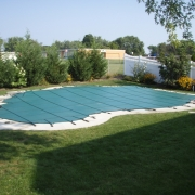 After - Green Solid Safety Cover with raised spa.